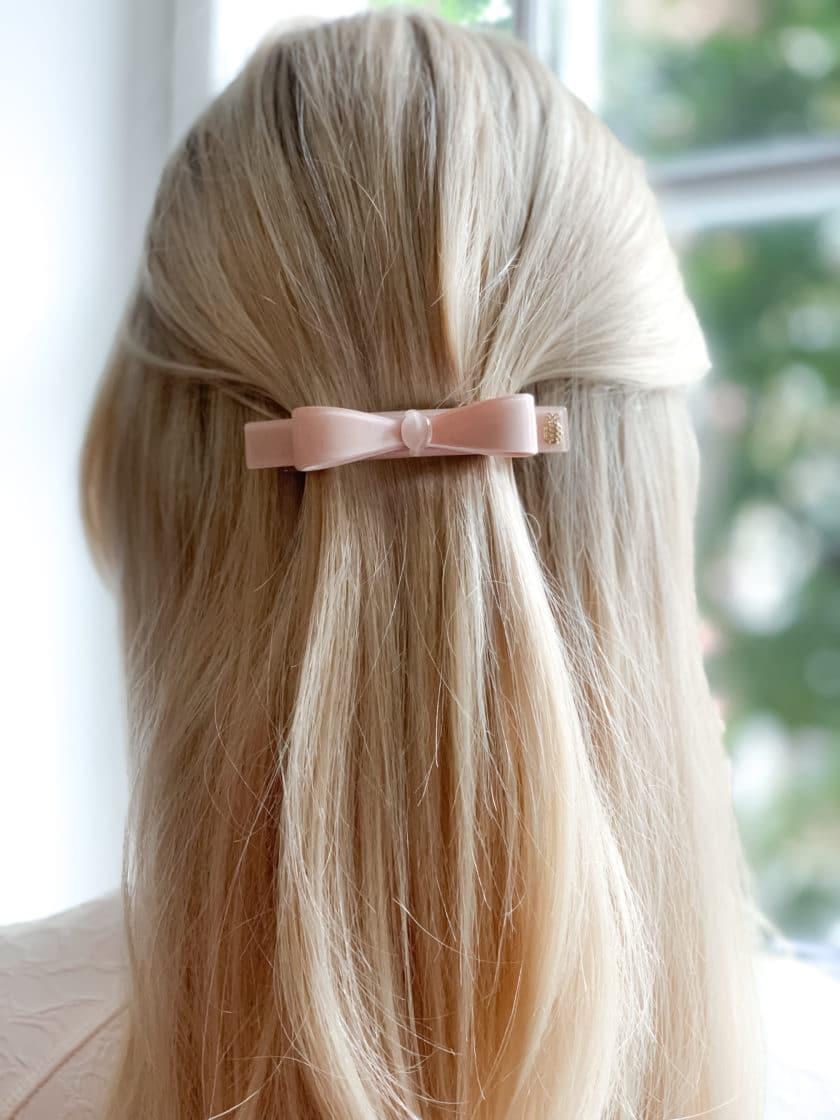 hårspänne rosett nude hår